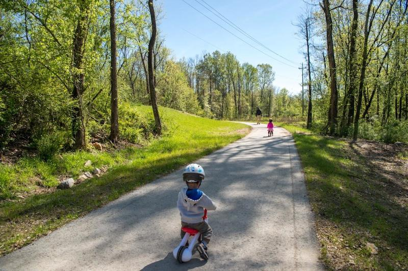 Young children play on the South Chickamuaga Greenway