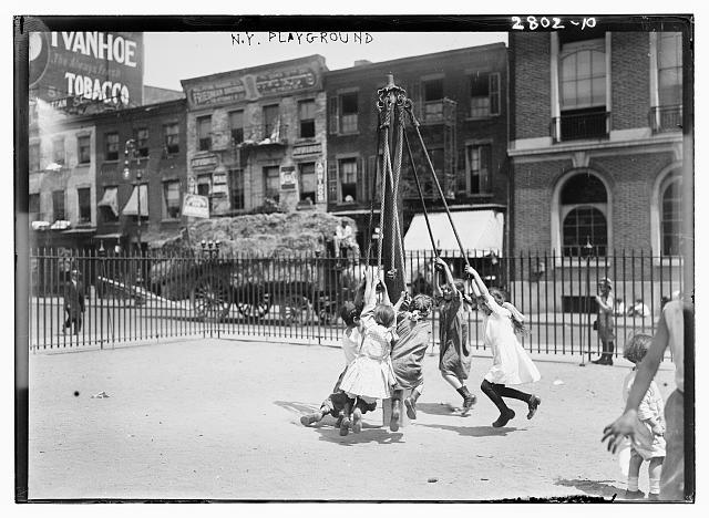 Children in a New York City playground in the early 1900s