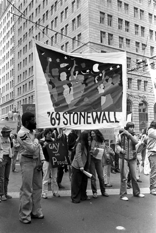 """At a 1970 gay pride march in San Francisco, people hold a banner that says, """"'69 Stonewall.'"""""""