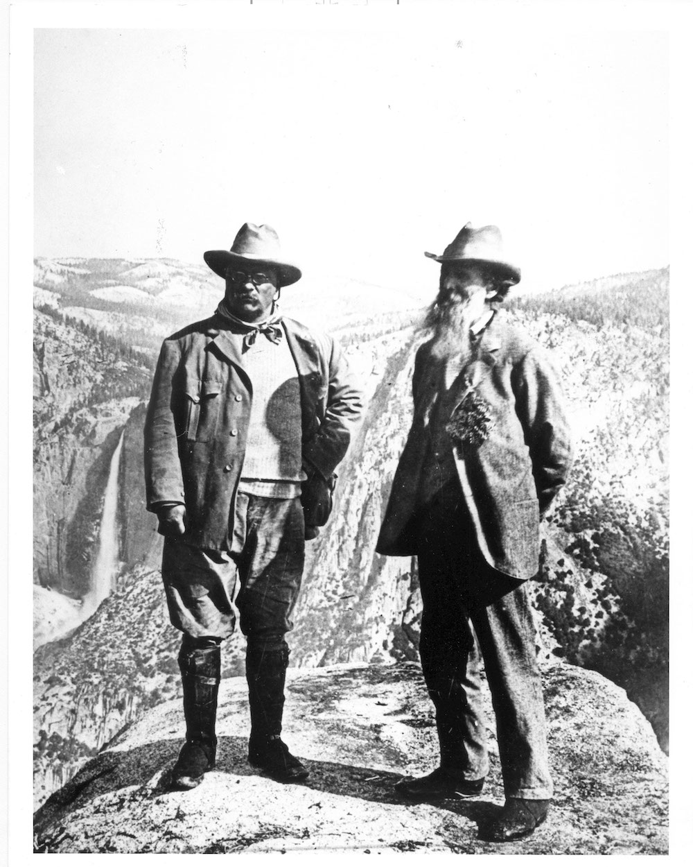 Theodore Roosevelt and John Muir stand together in Yosemite