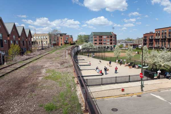 Next to a busy park, an abandoned rail corridor will be developed as part of the Bloomingdale Trail