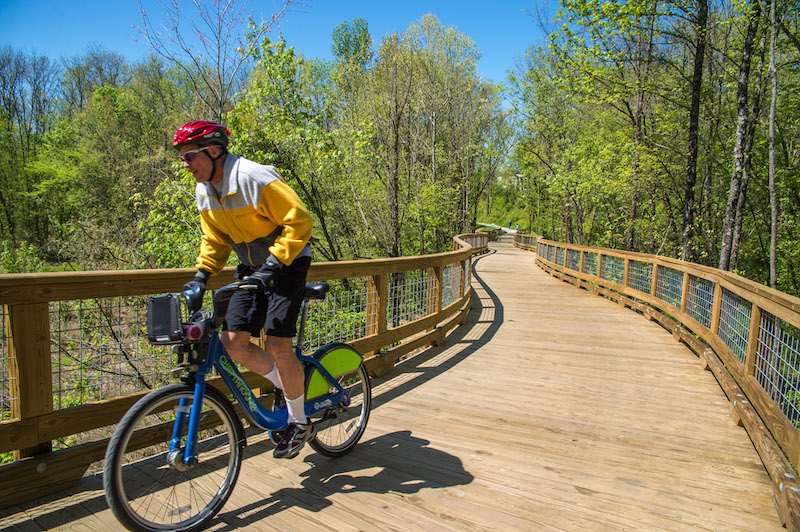 A man bikes the South Chickamauga Greenway
