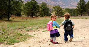 Two toddlers hike on the Ute Valley Gateway property