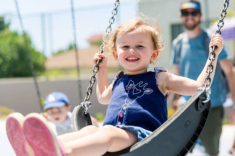 Photo of a kid on a swing