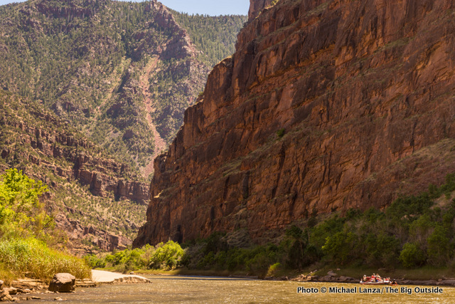 A raft floats down the Canyon of Lodore