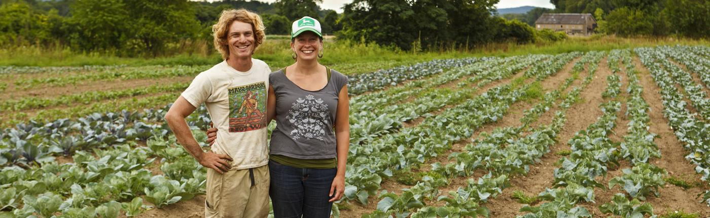 Jen Smith and her husband, Nate Frigard, on their new vegetable farm,