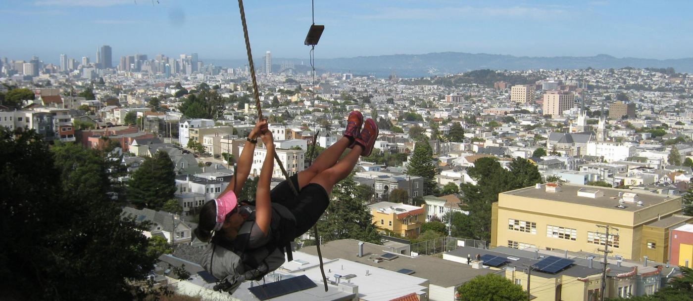 Liz Thomas on a hillside swing above San Francisco