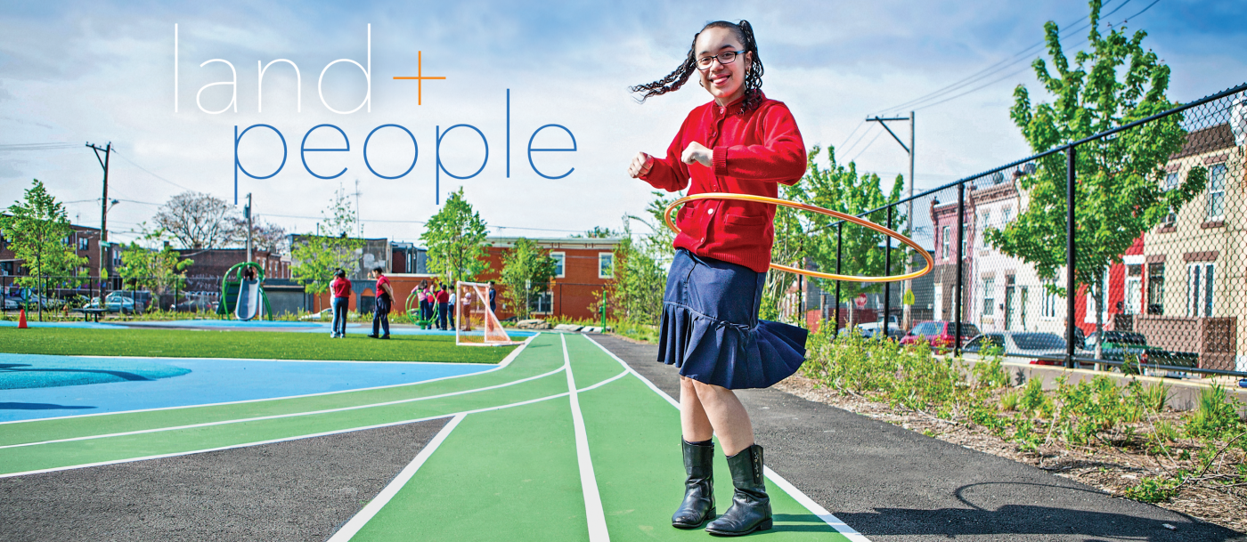 Cover of Land and People 2019: A little girl plays with her hula hoop on the playground.