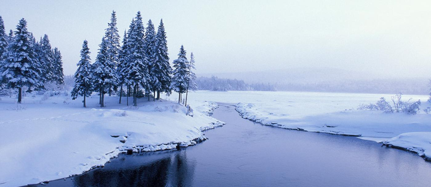 Photo of snow and a lake
