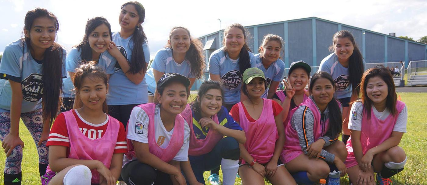 A group of young women pose for a picture in soccer gear