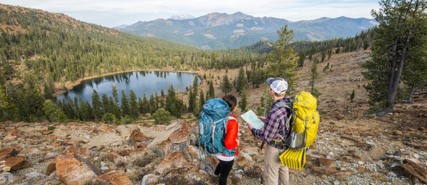A couple consults a map on the Pacific Crest Trail overlooking Bull Lake, part of the Trinity Divide acquisition.
