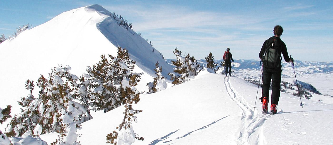 Cross-country skiers head up Red Top Mountain in the Wyoming Range
