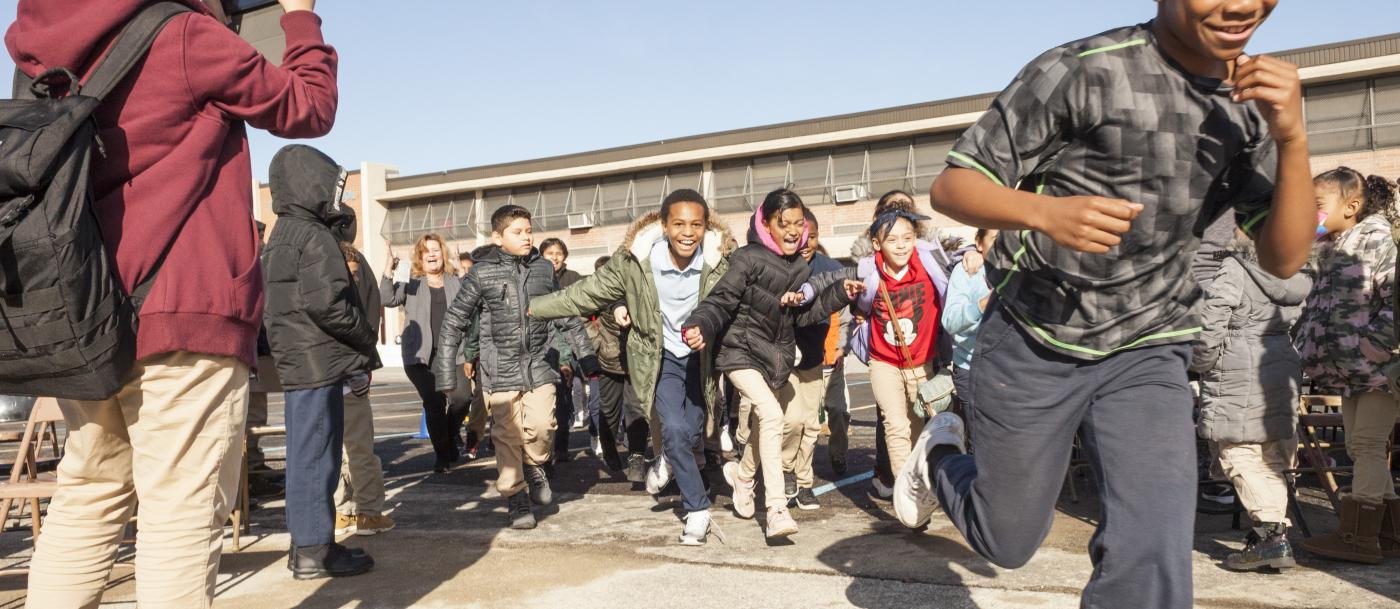 Kids run toward the camera at Coopers Poynt School in Camden, NJ