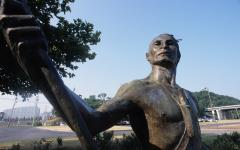 A statue of a Cherokee warrior stands at historic Ross' Landing.  A statue of a Cherokee warrior stands at historic Ross' Landing.