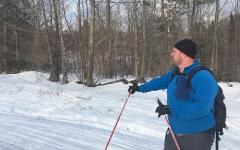 Photo of a cross country skier at Bethel Community Forest  Photo of a cross country skier at Bethel Community Forest