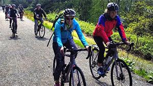 Photo of board members riding bicycles