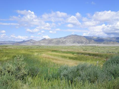 Photo of Hill Ranch with mountains in the background