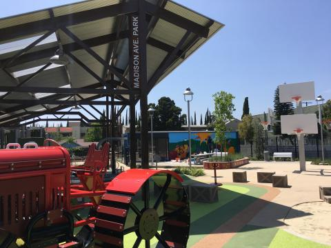 A basketball tree, silo slide, and tricycle track, and garden make up the new Madison Avenue Park & Community Garden