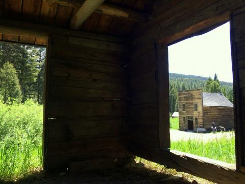 An old mining-town building seen through an empty door frame
