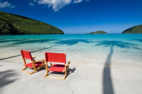 Two beach chairs on the white sandy beaches of Maho Bay on St. John, USVI