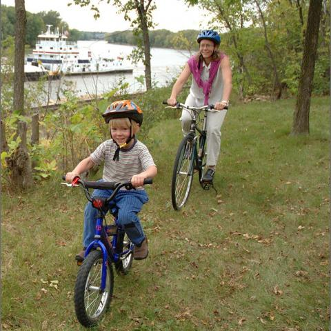 Photo of mom and son riding bikes
