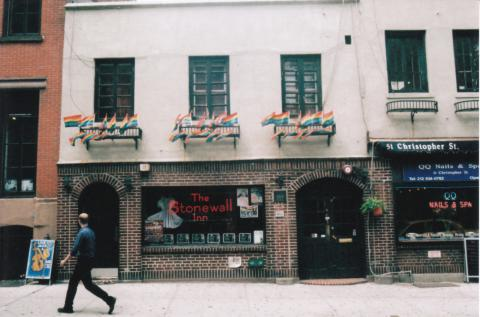 A man walks in front of the Stonewall Inn