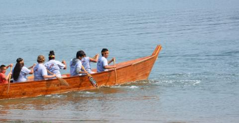 Youth in the Squaxin Island Tribe paddle a canoe