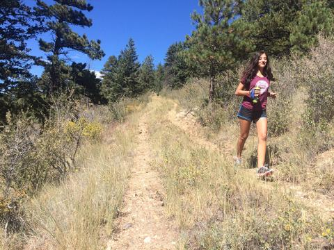 Photo of a woman running on a trail