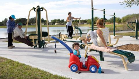 Local residents try out the new Fitness Zone equpment at Leisure Lake Park, Miami Dade