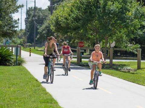 Photo of people riding bikes on Spanish Moss Trail