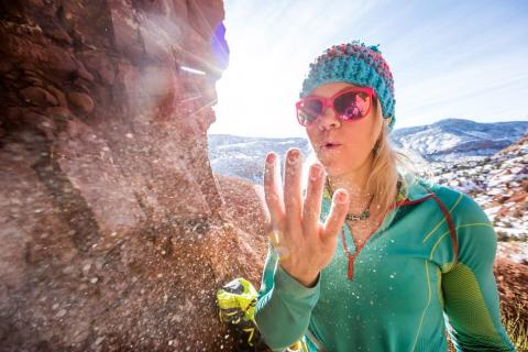 Anna Pfaff blows snow off her fingers