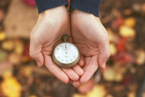 Hands holding a stopwatch