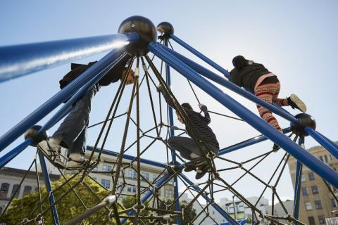 Children climb on a net structure at Boeddeker Park in San Francisco