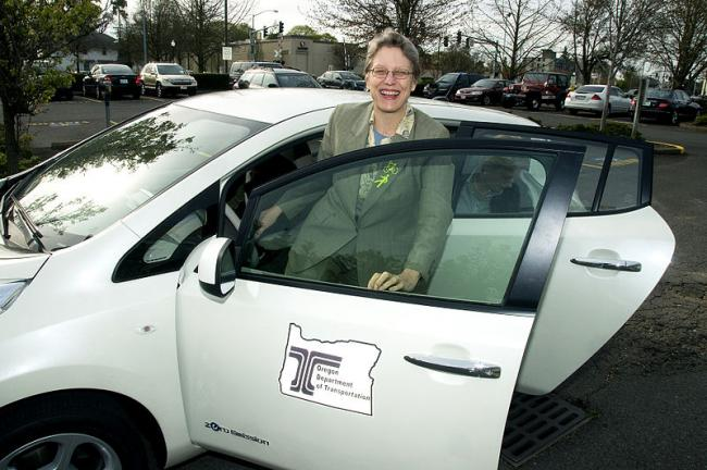 Gail Achterman in an electric vehicle