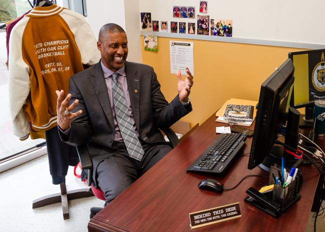 Derek Battie behind his desk at South Oak Cliff High School