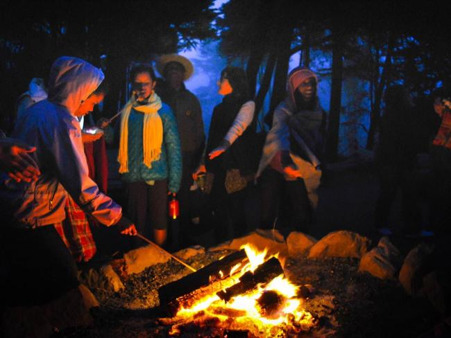 A group of people around a campfire
