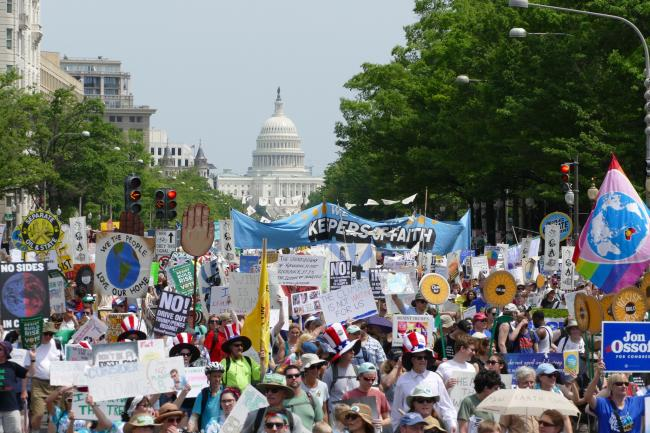 People march for climate in front of the US Capitol Building