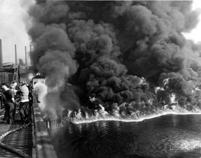 1952 archive photo of a fire on the surface of the Cuyahoga River