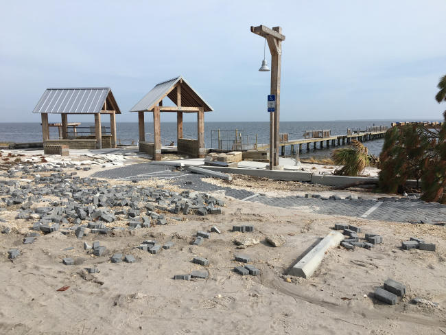 Two damaged pavilions at Island View Park after Hurricane Michael