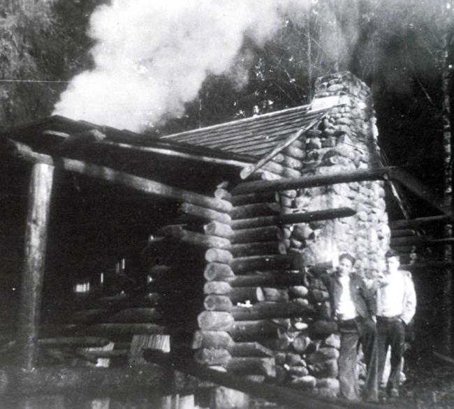 Jim and his brother Bob at the cabin they built near the Raging River in the 1930s.