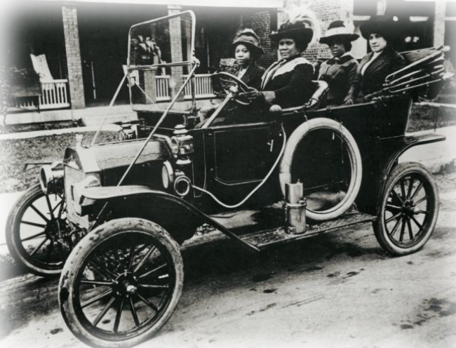 Madame CJ Walker driving a car with friends in 1911