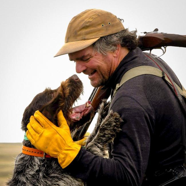 A man and a dog hunting
