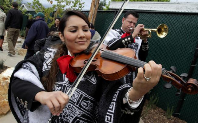 A mariachi band plays at the opening day celebration at Pine Avenue Park.  A mariachi band plays at the opening day celebration at Pine Avenue Park.