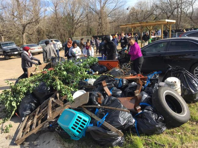 A mound of debris removed from a creek bed during a community cleanup day