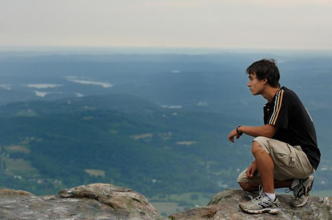 A young man checks out the view from Cumberland Plateau  A young man checks out the view from Cumberland Plateau