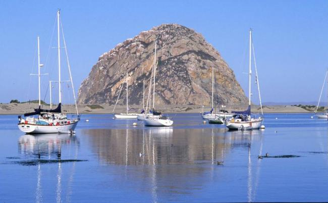 Boats anchored in Morro Bay with Morro Rock in the background