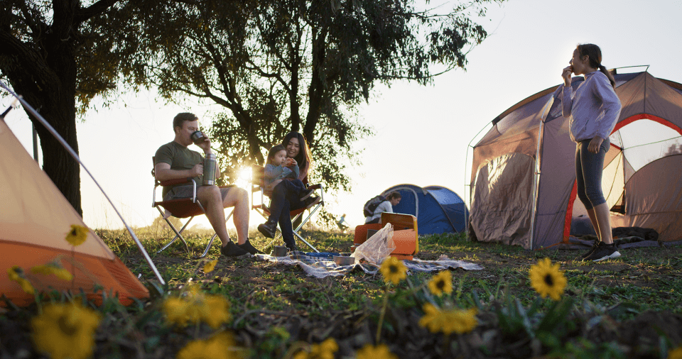 A family hangs out around a campsite at Banning Ranch