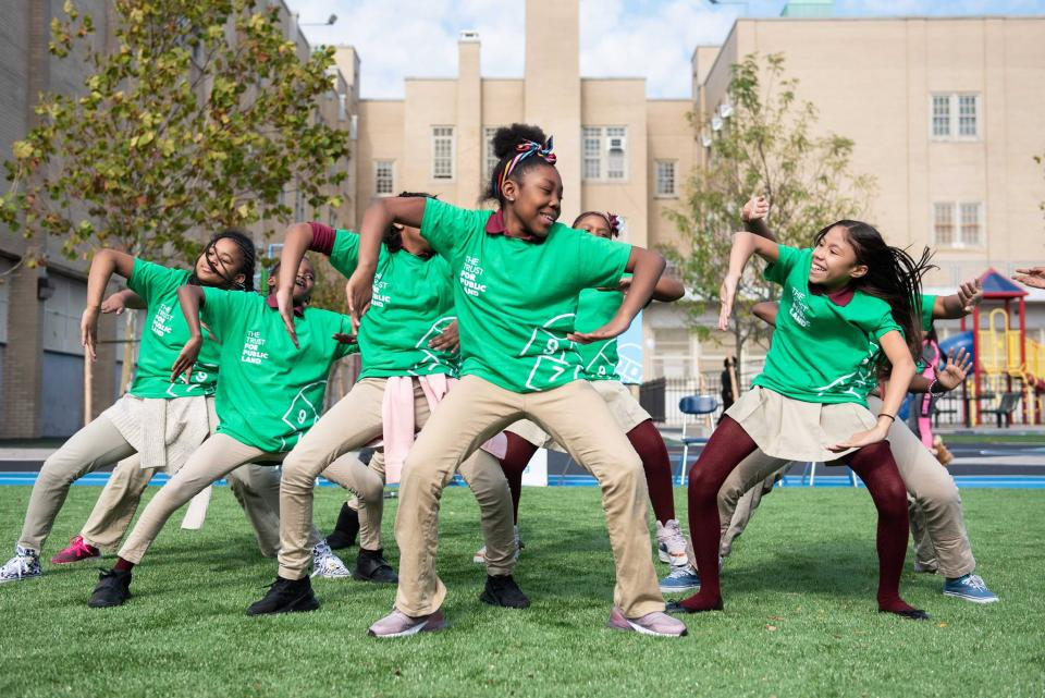 Students dance on a playground