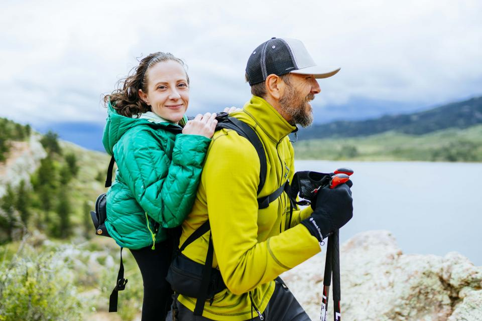 Melanie Knecht and Trevor Hahn smile at the camera on a hike