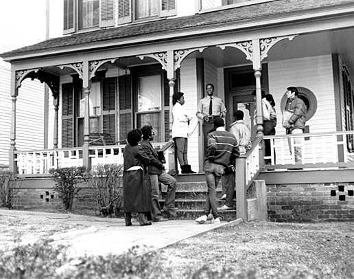 A park ranger on the porch of MLK's birthhome with visitors